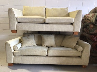 Lot 63 - Contemporary three piece suite with pale yellow upholstery comprising a pair of two seater settees 218 cm wide x 100cm deep and an armchair