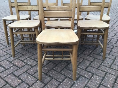 Lot 65 - Pine dining table on square legs 198cm wide x 88cm deep x 77cm high with a set of eight pine chapel chairs
