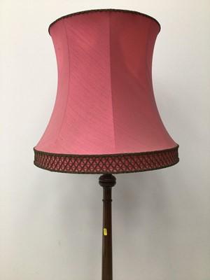 Lot 71 - Mahogany standard lamp with pink shade 157cm high excluding shade