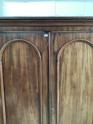 Lot 78 - Victorian mahogany double wardrobe with two arched pannelled 155cm wide x 66cm deep x 210 cm high