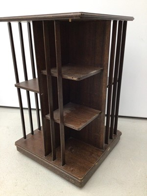 Lot 33 - walnut veneered circular coffee table, Edwardian mahogany tow tier table and an oak revolving bookcase (3)