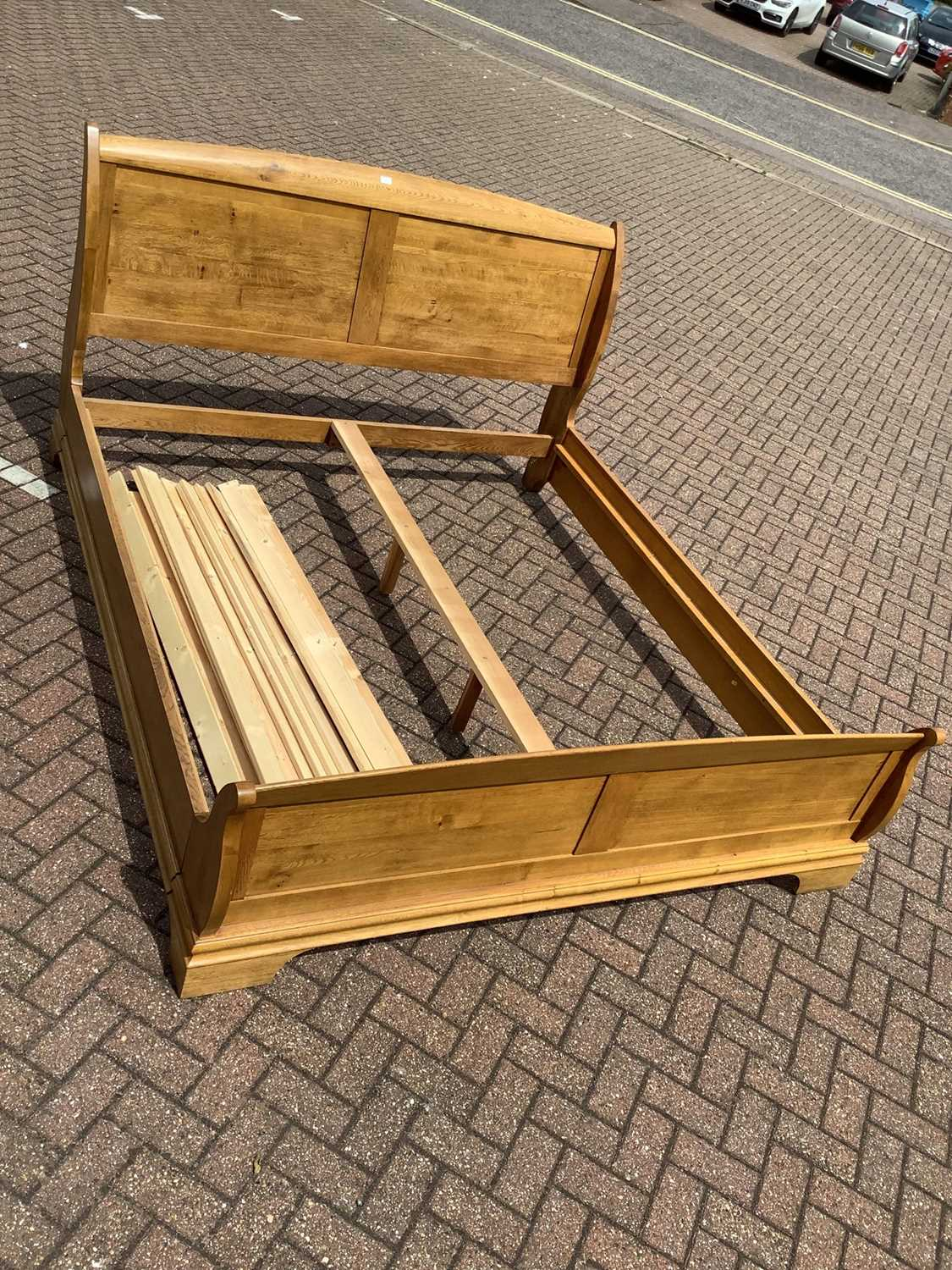 Lot 81 - Contemporary light oak double bed with side rails and slats 190cm wide