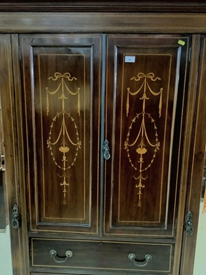Lot 82 - Edwardian inlaid mahogany wardrobe with two central panelled doors and four draws below flanked by two bevelled mirrored doors 193.5cm wide x 203cm high