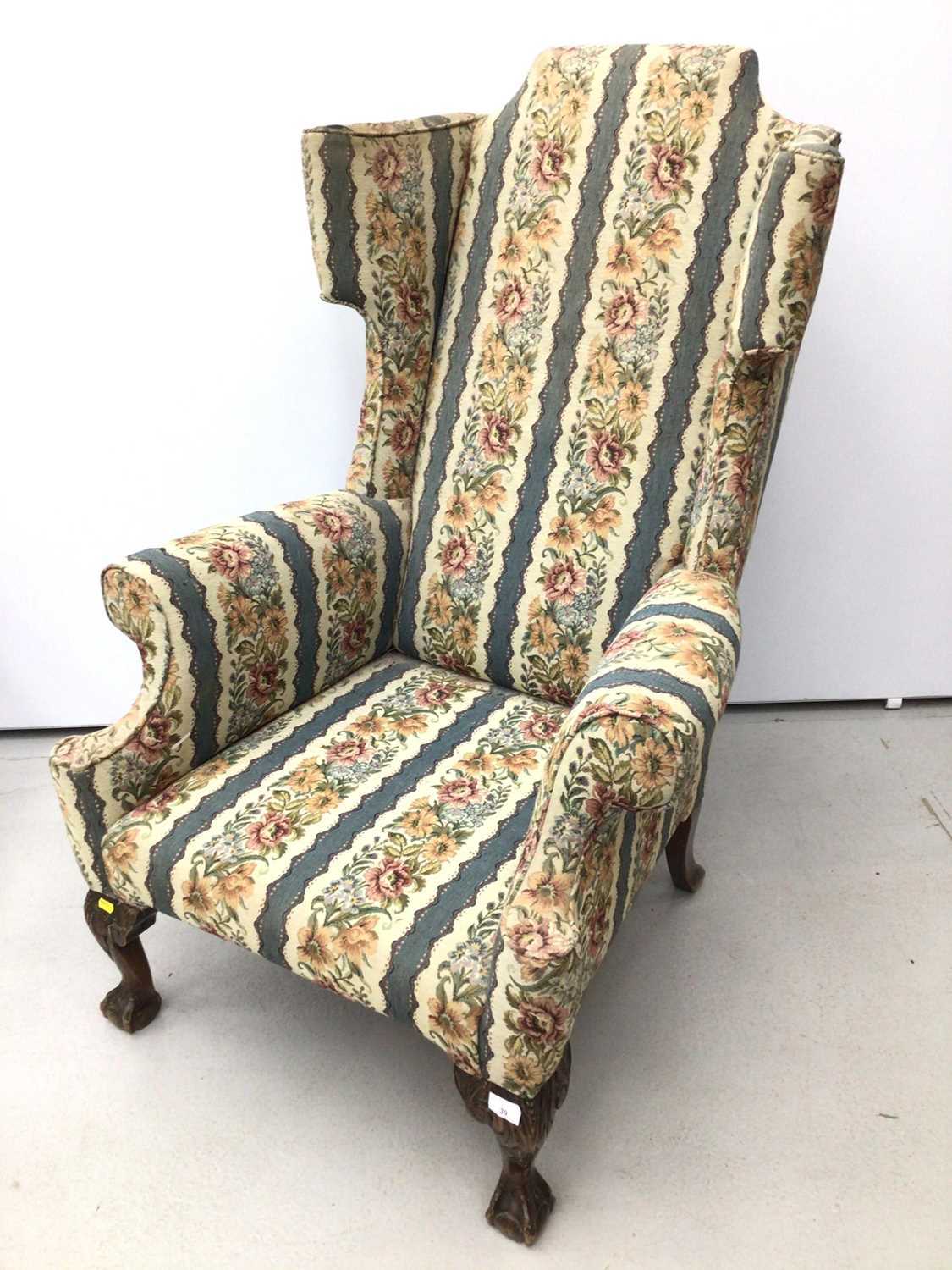 Lot 39 - Good quality Georgian style wing back armchair with floral upholstery on carved mahogany legs with claw and ball feet