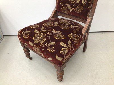 Lot 41 - Edwardian walnut framed easy chair with upholstered seat and back on turned front legs and castors