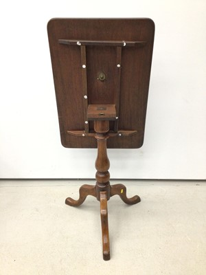Lot 45 - 19th century mahogany wine table with tilt top on turned column and three hipped splayed legs 66.5cm wide x 46cm