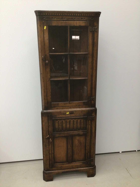 Lot 88 - Antique style oak two height corner cupboard with glazed door above and panel door below 61cm wide x 179cm high