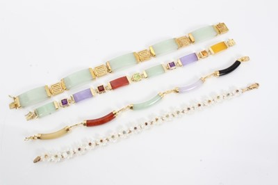Lot 92 - Four gold mounted hard stone bracelets