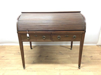 Lot 945 - Late 19th / early 20th century mahogany roll top desk