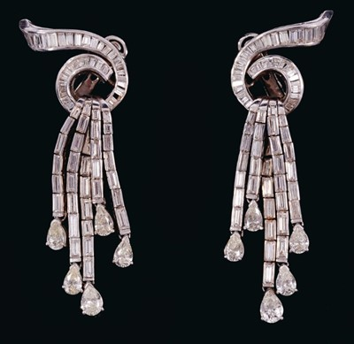 Lot 527 - Pair of Art Deco style diamond pendant earrings with a stylized waterfall design, the baguette cut diamond scroll issuing five articulated drops of further baguette cut diamonds, each suspending a...