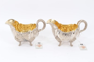 Lot 38 - Two Late 19th Century German Silver Sauce Boats of oval form, from the Royal Prussian Collection, with reeded border, repousse and chased with rocaille, flowers and foliage, with bifurcated foliage...