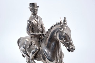 Lot 906 - Bernard Winskill (d. 1980) fine sterling silver model of a horse and rider, in the manner of a dressage competition, hallmarked and raised on black marble plinth, approximately 32cm long