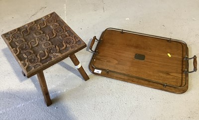 Lot 129 - Edwardian oak and brass two handled tray and a small carved stool