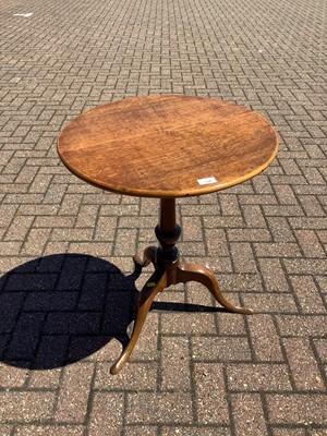 Lot 130 - Antique tilt top wine table on turned column and three splayed legs, 56cm diameter