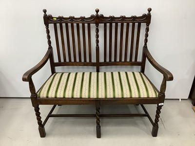 Lot 155 - 1920's oak rail back two seater bench with spiral twist supports