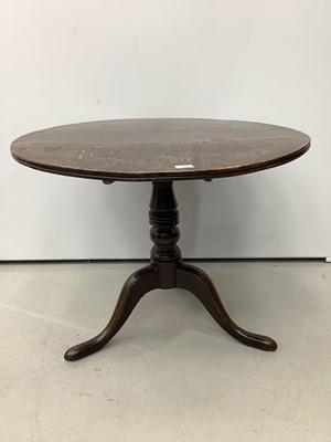 Lot 166 - Antique oak tilt top wine table on turned column and three splayed legs, 82cm diameter