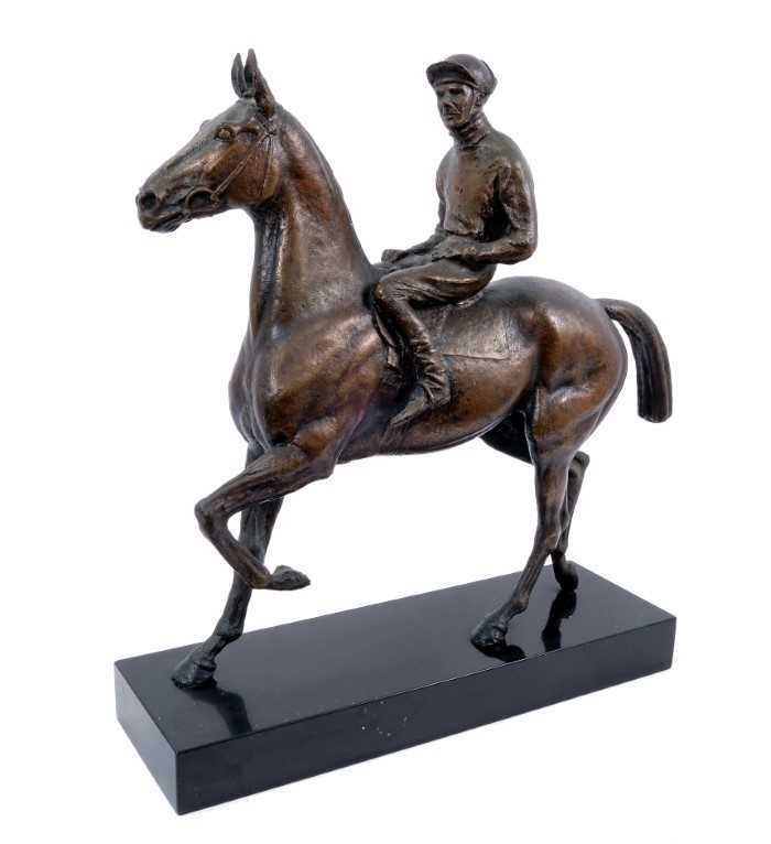 973 - Bernard Winskill (d. 1980) large bronze sculpture of Arkle with Pat Taaffe up, 50cm long, raised on black marble plinth, together with a certificate from the artist confirming purchase in 1966 for...