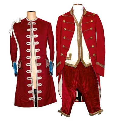 Lot 75 - Fine Edwardian footmans livery for the Earl of Listowel comprising a red frock coat with gold lace and gilt armorial buttons, pair red velvet breeches, cream waistcoat with gold lace and another co...
