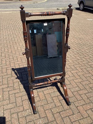 Lot 143 - Victorian mahogany framed cheval mirror with bevelled mirror plate and turned supports on splayed legs, 61.5cm wide x 146.5cm high