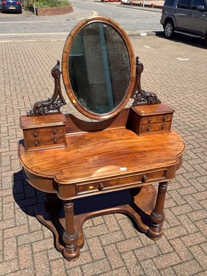 Lot 147 - Victorian mahogany dressing table with raised mirror back and drawers below on turned front legs joined by shaped stretcher, 121cm wide x 58cm deep