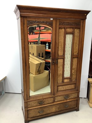 Lot 173 - Late Victorian walnut double wardrobe enclosed by one bevelled mirror door and one glazed and panelled door, with two short and one long drawer below, 132cm wide x 54cm deep x 209cm high