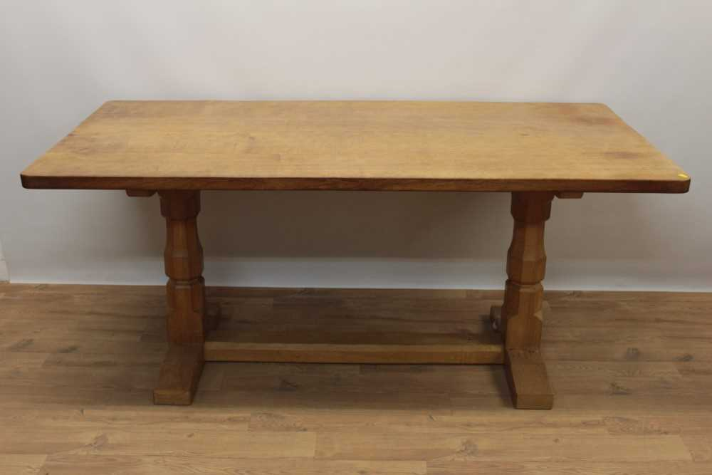 Lot 1296 - Robert Mouseman Thompson carved oak refectory table, rounded rectangular adzed top on facetted ends and sledge base united by a foot stretcher. signature mouse to one pedestal, 86 x 170cm