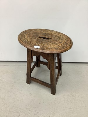 Lot 191 - Eastern folding occassional table with brass inlay