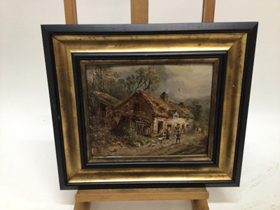 Lot 56 - William E. Ellis 1869 - 1923, oil on canvas laid on board, A Welsh scene with figures by a cottage, signed, in gilt frame. 22 x 27cm