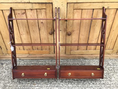 Lot 920 - Pair of reproduction open hanging shelves, each with pierced sides and single drawer