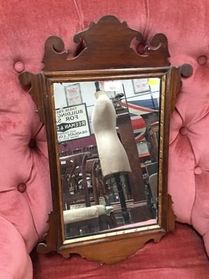 Lot 864 - Georgian mahogany wall mirror with shaped scroll frame