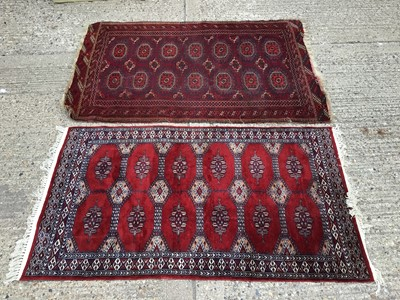 Lot 930 - Two Eastern rugs with geometric decoration on red ground 160x104cm, 156x89cm
