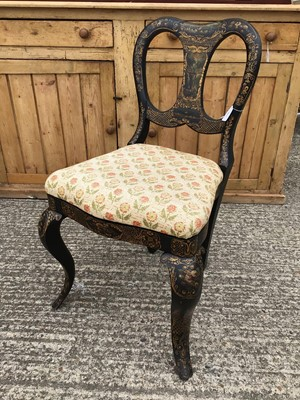 Lot 927 - 19th century lacquered side chair, the shaped back painted with waterfall and coastal scene within gilt scroll borders, drop-in seat, one scroll legs