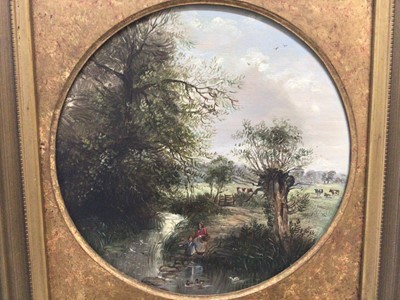 Lot 144 - Manner of George Lara, oil on circular board, a pair country scenes with figures by a river and a figure near a cottage (2)
