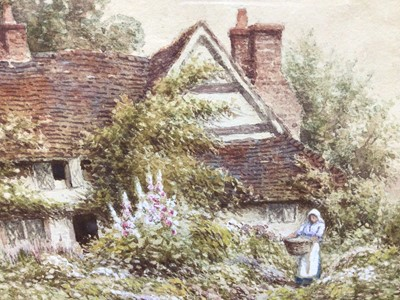 Lot 143 - W Carter, pair watercolours, A cottage garden with a woman holding a basket, signed lower left, and a cottage and garden, signed lower left