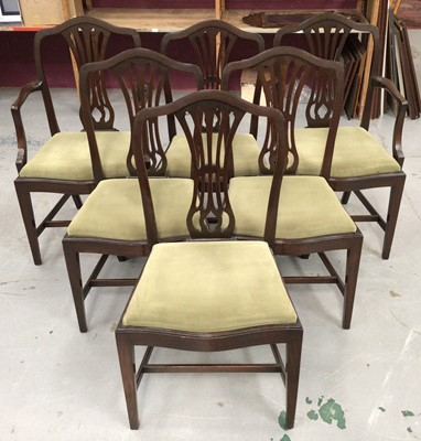 Lot 858 - Set of six George III style mahogany dining chairs, each with arched pierced back and slip in seat, to include a pair of carvers