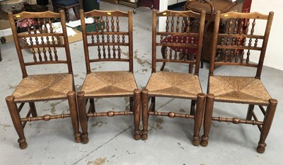 Lot 851 - Set of four 19th century style Lancashire spindle back chairs with rush seats on turned legs and stretchers