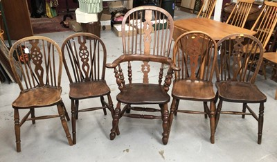 Lot 853 - 19th century Windsor elbow chair and a set of four Windsor wheel back kitchen chairs with solid seats on turned legs
