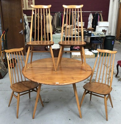 Lot 852 - Ercol Golden Dawn drop leaf table and set of four Ercol stick back chairs