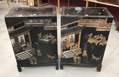 Lot 855 - Pair of Chinese black lacquered and chinoiserie decorated cabinets together with a consol table