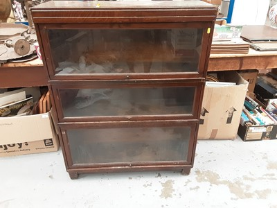Lot 889 - Oak three section Globe - Wernicke bookcase, with label to interior