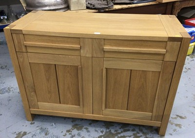 Lot 862 - Contemporary light oak sideboard with two draws above two panelled doors