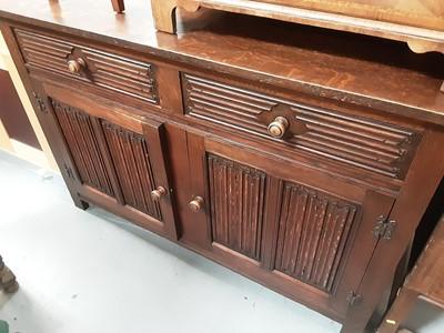 Lot 876 - 17th century style oak sideboard with linen fold panels