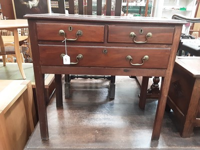 Lot 871 - George III mahogany mahogany lowboy with two short and one long drawer with brass swan neck handles on moulded square chamfered legs