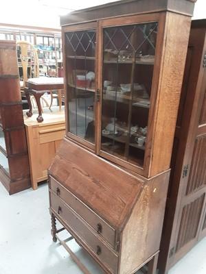 Lot 877 - 1930s oak two height bureau bookcase