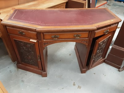 Lot 885 - Good quality late Victorian/Edwardian carved walnut kneehole desk with leather lined top, three drawers and two carved panelled doors below, 143cm wide, 61cm deep, 80cm high
