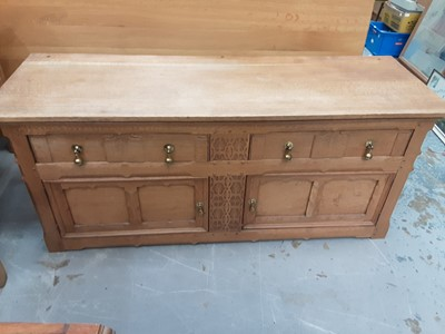 Lot 888 - Low oak sideboard with two drawers and two panelled doors below, 152cm wide, 51cm deep, 65.5cm high
