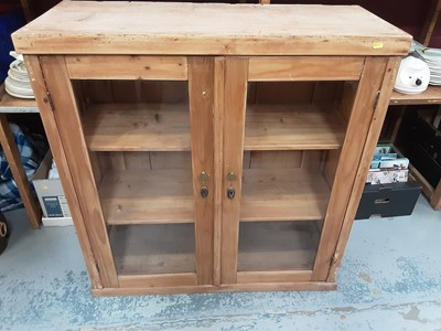 Lot 891 - Pine bookcase with shelved interior enclosed by two glazed doors, 97cm wide, 38.5cm deep, 100.5cm high
