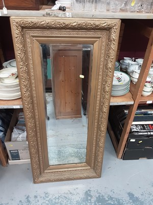 Lot 899 - Wall mirror in ornate gilt frame, 53.5cm wide, 115cm high