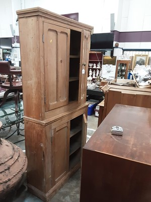 Lot 909 - Large pine bookcase with shelved interior enclosed by four panelled doors, 96cm wide, 32cm deep, 197cm high