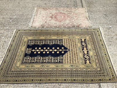 Lot 931 - Eastern rug on blue and Beije ground and one other 182x120cm, 135x85cm
